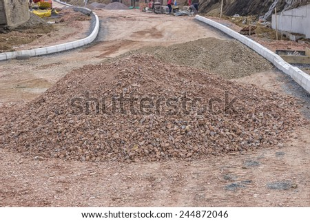 BELGRADE, SERBIA - JANUARY 17: Pile of crushed gravel on road construction site. Road construction with heap of gravel in January 2015. - stock photo