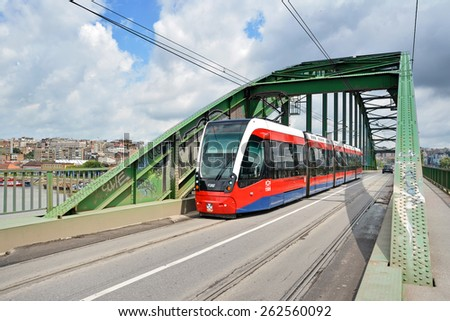 BELGRADE, SERBIA, JULY 3,2014: Modern tram passing through Old Sava Bridge, It is the smallest road bridge in the Serbian capital and is used both for car and tram traffic. - stock photo