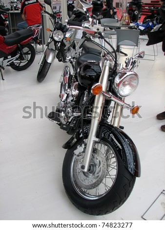 "BELGRADE, SERBIA - MARCH 16: A Yamaha V Star on display at the 4th International Motor Show  ""Motopassion"" on March 16, 2009 in Belgrade, Serbia. - stock photo"