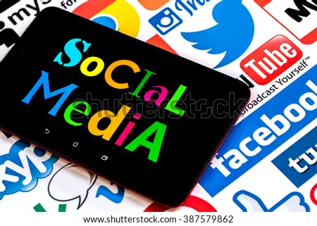 BELGRADE, SERBIA - MARCH 08 2016 : Popular social media icons Facebook, Twitter, Google, You tube, Vimeo, and others, printed on white paper with Social media text on tablet - stock photo