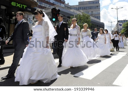 BELGRADE, SERBIA - MAY 18, 2014: Brides and grooms walks on street after mass wedding ceremony on May 18 2014 in Belgrade