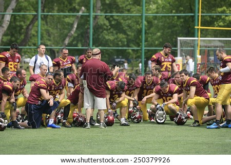 Belgrade, Serbia - May 05, 2014: Team the Wolves together after victory. American Football Match Between Belgrade Wolves And Blue Dragon in Belgrade. The Wolves team is winner. - stock photo