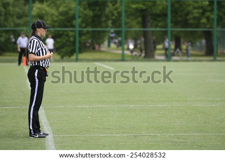 Belgrade, Serbia - May 05, 2014: The only female football referee Ivana Lazic in Serbia. American Football Match Between Belgrade Wolves And Blue Dragon in Belgrade. The Wolves team is winner.