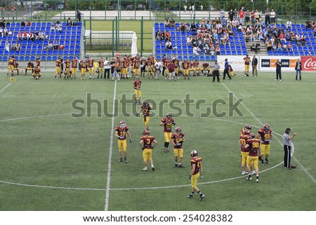 Belgrade, Serbia - May 05, 2014: The teams at the break. American Football Match Between Belgrade Wolves And Blue Dragon in Belgrade. The Wolves team is winner. - stock photo