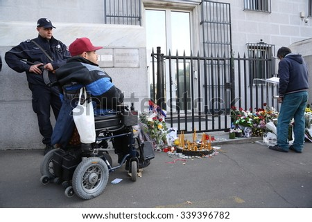 Belgrade, Serbia - November 15, 2015: In front of France Embassy in Belgrade, people coming to pay tribute and lay flowers to memory of the victims of the November 13 terror attacks in Paris.