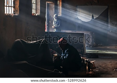 Belgrade, Serbia- November 29Th 2016: About thousand migrants find shelter from cold weather behind the main railway station in Belgrade. They could continue their journey to Europe. Belgrade, Serbia.