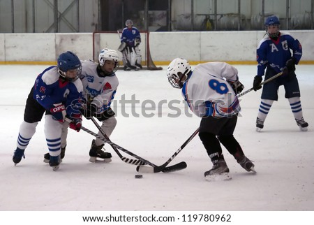 "BELGRADE,SERBIA-NOVEMBER 24:Unidentified ice hockey players in action with puck at "" Belgrade trophy  ice hockey tournament "". November 24,2012 in Belgrade,Serbia"
