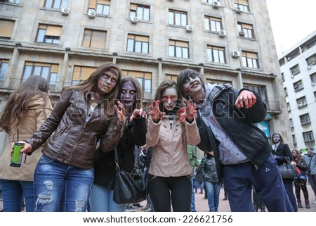 Belgrade, Serbia - October 26, 2013: People dressed as a zombie parades on a street during a zombie walk in Belgrade, The zombie walk is part of the events of a upcoming Serbian SF movie festival
