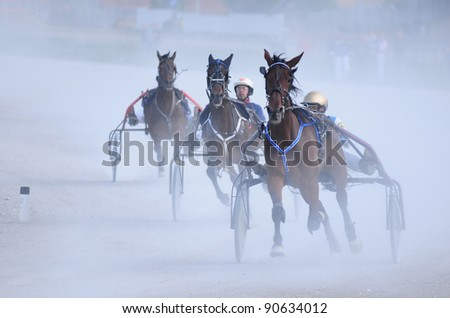 """BELGRADE, SERBIA-SEPTEMBER 2: Unidentified group horses and jockeys just before the finish line in race """"Balaton-1"""" on September 2, 2011 in Belgrade, Serbia - stock photo"""