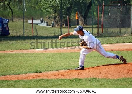 BELGRADE SERBIA - SEPTEMBER 24: Unidentified player in action on the baseball match Belgrade (white) vs. Vojvode (blue) on the Ada field on September 24, 2011 in Belgrade, Serbia. - stock photo
