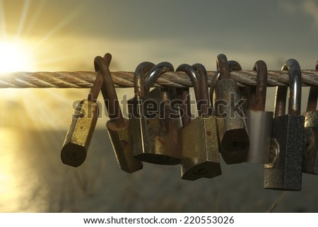 Belief of people that their love will as strong as pair of lock which still there from time to time. - stock photo