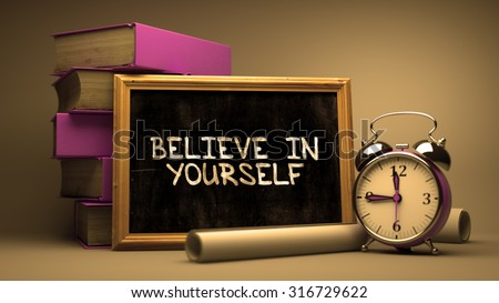 Believe in Yourself Handwritten on Chalkboard. Time Concept. Composition with Chalkboard and Stack of Books, Alarm Clock and Scrolls on Blurred Background. Toned Image. - stock photo