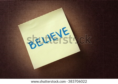 believe text on yellow sticky note - stock photo