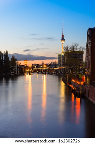 Belin, evening view on Alexanderplatz from river Spree - stock photo