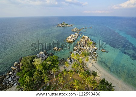 Belitung's beach - the view upon the lighthouse - stock photo