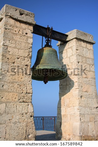 Bell from Notre Dame de Paris isolated on white. Now situated in Chersonese, Sevastopol