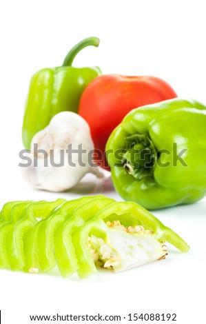 bell pepper tomato and garlic on white background - stock photo