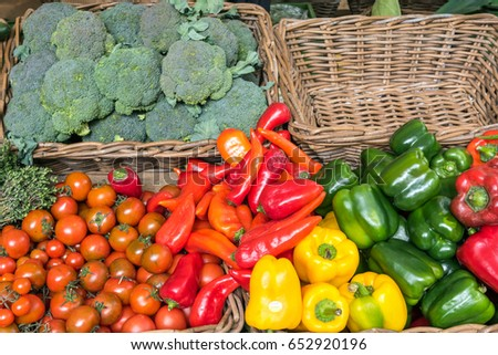 Bell pepper, tomatoes and broccoli for sale at a market