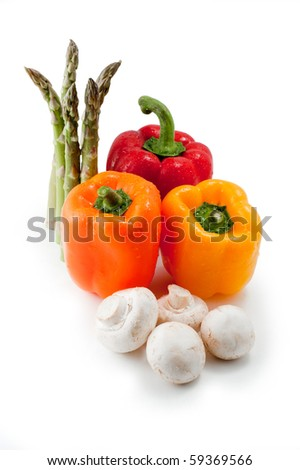 bell peppers and asparagus with mushrooms isolated on white - stock photo