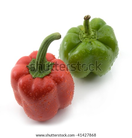 Bell peppers red and green with water droplets on them. High resolution image. Subject isolated on white background. - stock photo