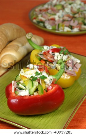 Bell peppers stuffed with vegetables, ham, edam cheese and blue vein cheese