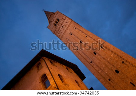 Bell tower and old building in the historical center of Pordenone, Italy - stock photo