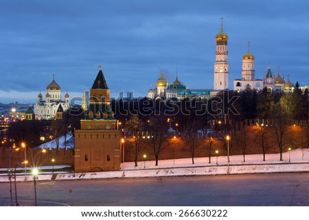 Bell tower of Ivan Great, Kremlin wall and Cathedral of Christ Saviour at evening in Moscow - stock photo