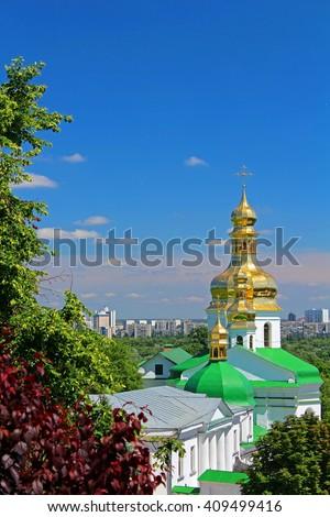 Bell tower of the lower caves and Holy Cross Church Kiev Pechersk Lavra Monastery, Kyiv, Ukraine - stock photo