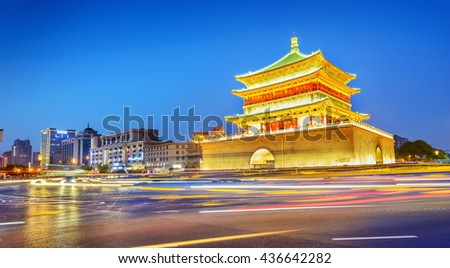 Bell Tower of Xi'an at night. Built in 1384 during the early Ming Dynasty, is a symbol of the city of Xi'an and one of the grandest of its kind in China. Located in Xi'an City, Shanxi Province, China. - stock photo