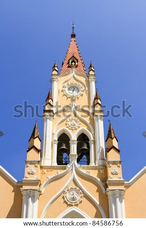 Bell tower with blue sky in the background (Antigua Guatemala)