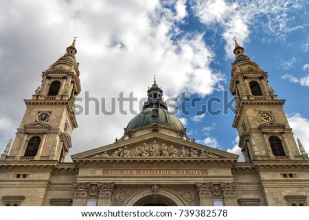 "Bell towers and top of St. Stephen's Basilica, a Roman Catholic church in Budapest, Hungary. This is the most important church in Hungary. Text translation: ""I am the way, the truth and the life""."