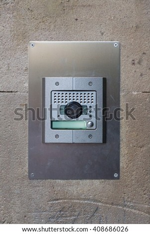 bell with interphone system on stone wall - stock photo