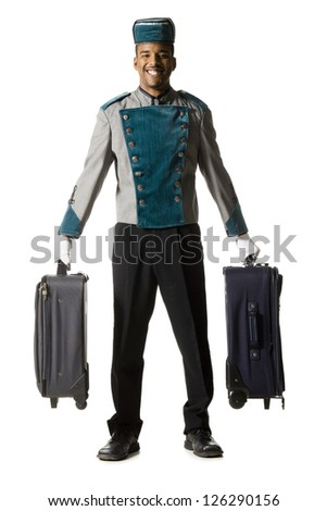 Bellboy with luggage smiling - stock photo