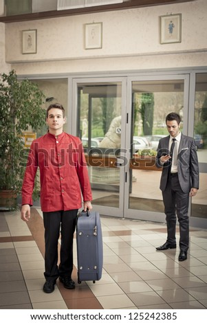 bellhop in the hotel's hall near a businessman