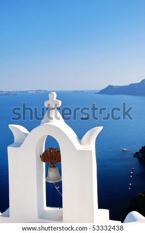 Bells and blue sea in Santorini island, Greece - stock photo