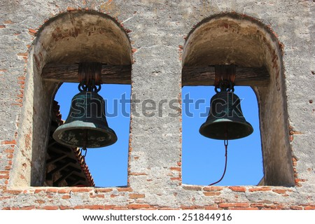 Bells at the bell tower in Mission San Juan Capistrano was erected a year after the bell tower at the Great Stone Church was toppled in the 1812 earthquake. - stock photo