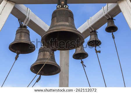 Bells on belfry Orthodox Church of the Icon of the Theotokos in the village Khuzhir on Olkhon Island in the middle of Lake Baikal, Russia