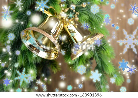 Bells with Christmas decoration on wooden background - stock photo
