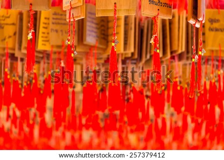 Bells with red thread in the Chinese Shrine - stock photo