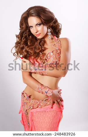 Belly dancer woman Arabian beauty, oriental lady, long curly hair brunette, indian girl, bellydance, studio isolated. series