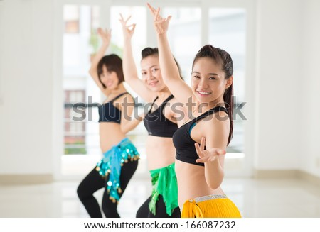 Belly dancers performing together in the studio - stock photo