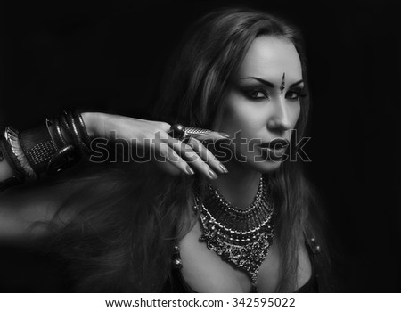 Bellydance, Tribal Fusion. Beautiful Young Woman in Sexy Clothing with Eastern Makeup and Luxury Oriental Jewelry. Beautiful Girl Hot Bollywood Dancer (Sensitive Bellydancer). Harem. black and white