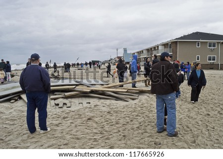 BELMAR, NEW JERSEY/USA- OCTOBER 30: People survey damage along the beach the day after Hurricane Sandy on October 30, 2012 in Belmar New Jersey.