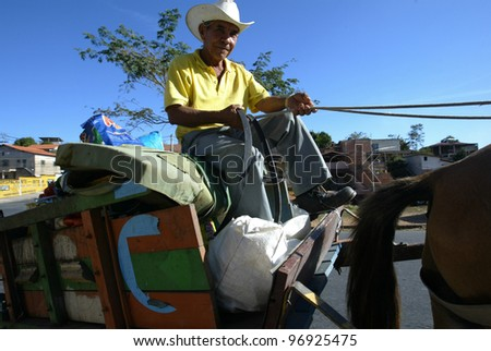 BELO HORIZONTE, BRAZIL - JULY 23:  An unidentified local worker rides a horse drawn carriage July 23, 2005 in Belo Horizonte, Brazil. - stock photo