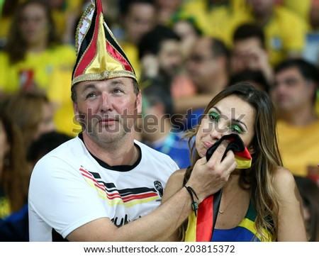 BELO HORIZONTE, BRAZIL - July 8, 2014: Soccer fans of Germany and Brazil during the World Cup Semi-finals game between Brazil and Germany at Mineirao Stadium. NO USE IN BRAZIL.