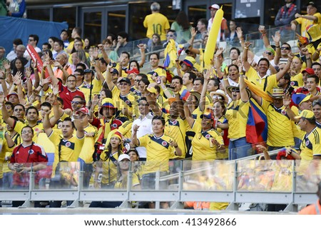 BELO HORIZONTE, BRAZIL - June 14, 2014: Colombia fans during the 2014 World Cup. Colombia is facing Greece in the Group C at Minerao Stadium - stock photo