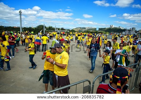 BELO HORIZONTE, BRAZIL - JUNE 14: Colombian fans outside the stadium supporting their national team during Colombia's first game of the 2014 FIFA World Cup in Brazil against Greece, on June 14, 2014  - stock photo
