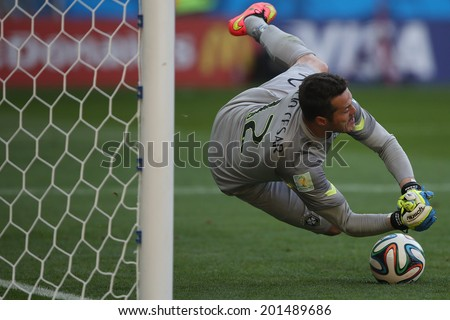 BELO HORIZONTE, BRAZIL - June 28, 2014: Julio Cesar of Brazil saves a penalty during the 2014 World Cup Round of 16 game between Brazil and Chile at Mineirao Stadium. No Use in Brazil. - stock photo