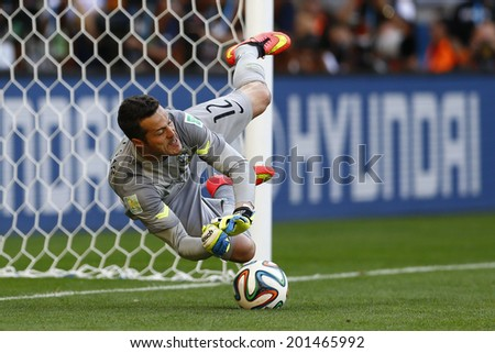 BELO HORIZONTE, BRAZIL - June 28, 2014: Julio Cezar goalkeeper of Brazil saves a penalty during the 2014 World Cup Round of 16 game between Brazil and Chile at Mineirao Stadium. No Use in Brazil. - stock photo