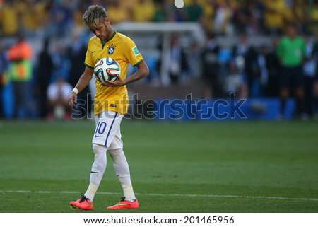 BELO HORIZONTE, BRAZIL - June 28, 2014: Neymar of Brazil preparing for a penalty kick during the 2014 World Cup Round of 16 game between Brazil and Chile at Mineirao Stadium. No Use in Brazil. - stock photo